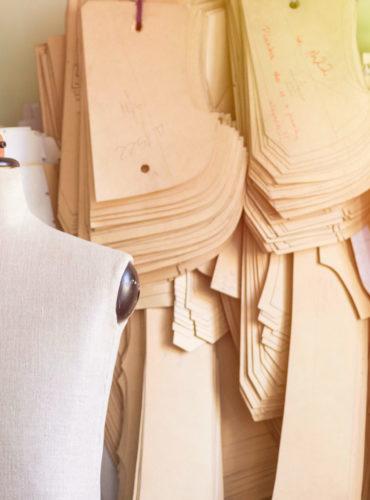 Mannequin,In,Bespoke,Tailor,Studio,Against,Cardboard,Sewing,Patterns.